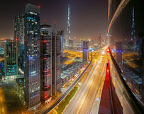 Dubai night view. Night view to Sheikh Zayed road and Burj Khalifa from one of skyscrapers stock image
