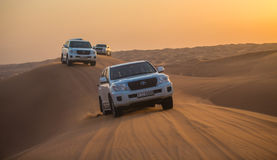 DUBAI - OCTOBER 21: Driving on jeeps on the desert, traditional Royalty Free Stock Photo