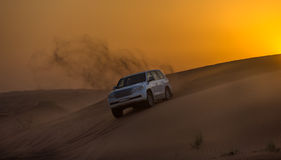 DUBAI - OCTOBER 21: Driving on jeeps on the desert, traditional Royalty Free Stock Photos