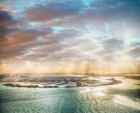 Dubai Palm Jumeirah Island with sun says Stock Images