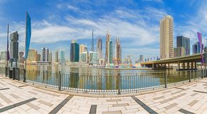 Dubai - The panorama with the bridge over the new Canal and Downtown. Royalty Free Stock Image