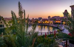Dubai parks Riverland at sunset. With the beautiful palm trees and architure buildings Royalty Free Stock Photos