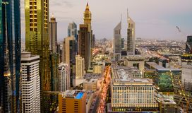 Dubai rush hour. Bird`s eye view of Dubai Financial District skyline and rush hour traffic at dusk Royalty Free Stock Photo