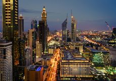 Dubai rush hour. Bird`s eye view of Dubai Financial District skyline and rush hour traffic after sunset Royalty Free Stock Image