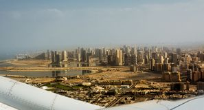 Dubai`s buildings seen from the airplane taking off. The Dubai`s buildings seen from the airplane taking off stock images