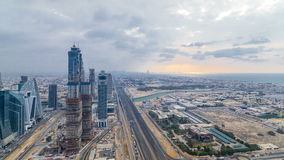Dubai`s business bay towers before sunset timelapse. Rooftop view of some skyscrapers and new towers under construction. Dubai water canal with bridges and stock video footage