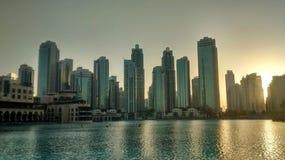 Dubais skyline during sunset stock images