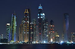 Dubai's twin towers. The towers at night with the mono rail in the foreground Stock Photos