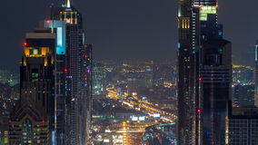 Dubai Sheikh Zayed Road night timelapse near Dubai Downtown Closer Look shows the density of these roads. Dubai Sheikh Zayed Road traffic night timelapse near stock video