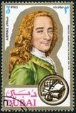 DUBAI - 1971: shows Francois Marie Arouet de Voltaire 1694-1778, writer, portraits. DUBAI - CIRCA 1971: A stamp printed in Dubai shows Francois Marie Arouet de royalty free stock photo