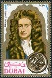 DUBAI - 1971: shows Sir Isaac Newton 1642-1727, scientist, portraits. DUBAI - CIRCA 1971: A stamp printed in Dubai shows Sir Isaac Newton 1642-1727, scientist stock photo