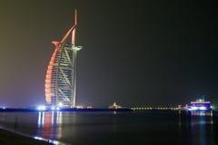 Dubai sky line and burj al arab. Night view of burj al arab from jumeirah beach Royalty Free Stock Image