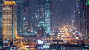 Dubai skyline with beautiful city center lights and Sheikh Zayed road traffic night timelapse, Dubai, United Arab. Dubai skyline with beautiful city center stock video