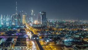 Dubai skyline with beautiful city center lights and Sheikh Zayed road traffic night timelapse, Dubai, United Arab. Dubai skyline with beautiful city center stock footage
