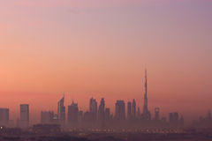 Dubai skyline and Burj Khalifa. The sunrise view of the modern buildings of Dubai including the world's tallest building Burj Khalifa and  Emirates Towers Royalty Free Stock Image
