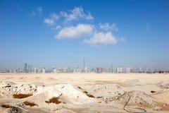 Dubai skyline from the desert Royalty Free Stock Photos
