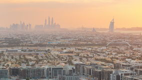 Dubai skyline with Dubai Marina skyscrapers and coastline at sunset timelapse with seven star luxury hotel in Dubai, UAE stock footage