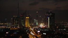 Dubai skyline at dusk down Sheikh Zayed Road stock video