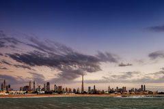Dubai skyline at dusk seen from the Gulf Coast Stock Image