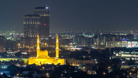 Dubai skyline with The Jumeirah Mosque illuminated at night timelapse. Dubai, United Arab Emirates stock video footage