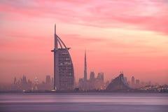 Dubai skyline lighted with beautiful sunrise colors stock photos