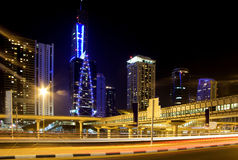 Dubai skyline with metro and skyscraper Stock Photos