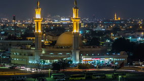 Dubai skyline with Mosque illuminated at night timelapse. Dubai, United Arab Emirates stock footage