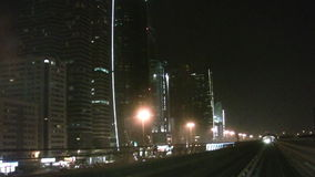 Dubai skyline at night. Shot from the driverless metro - in the background skyscrapers are seenn stock video