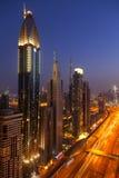 Dubai skyline at night Stock Images