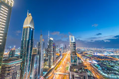 Dubai skyline over Sheikh Zayed road at night Stock Photography
