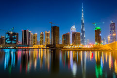 Dubai skyline. The skyline of Dubai with the reflection in the lake Stock Image