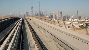 Dubai skyline. Shot from the driverless metro - in the background skyscrapers are seen, including Burj Khalifa, the tallest building in the world stock footage