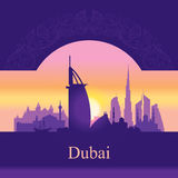 Dubai skyline silhouette on sunset background Stock Photography