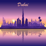 Dubai skyline silhouette on sunset background Stock Photo