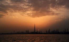 Dubai skyline with sunset Stock Photos