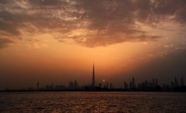 Dubai skyline with sunset. View from festival city Stock Photos
