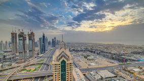 Dubai skyline timelapse at sunset with beautiful city center skyscrapers and Sheikh Zayed road traffic, Dubai, United stock video footage