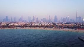 Dubai skyline view from coast or beach with city landscape and skyscrapers with Burj Khalifa background. Amazing aerial. View of Dubai from Burj Khalifa tower stock video footage