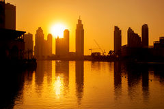 Dubai with skyscrapers against sunset in United Arab Emirates Royalty Free Stock Images