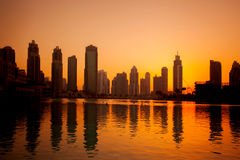 Dubai with skyscrapers against sunset in United Arab Emirates Royalty Free Stock Image