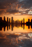 Dubai with skyscrapers against sunset in United Arab Emirates Stock Images