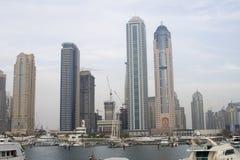 Dubai - Skyscrapers at marina. Tall skyscrapers overlooking one marina in the cosmopolitan city of Dubai... Shot at dusk on a foggy gloomy day Royalty Free Stock Photo