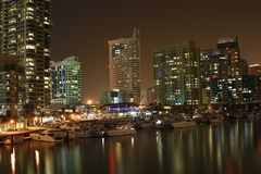 Dubai Skyscrapers at Night. Night view of Dubai with lit skyscrapers overlooking a small marina and a small lake Royalty Free Stock Image