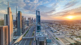 Dubai skyscrapers sunset timelapse evening time. Dubai Metro station and traffic on Sheikh Zayed Road stock video footage