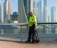 Dubai street cleaner Stock Image