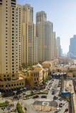 Dubai street. DUBAI - MARCH 21, 2013: Dubai street The Walk at Dubai Marina taken on March 21, 2013 in Dubai, United Arab Emirates Royalty Free Stock Images