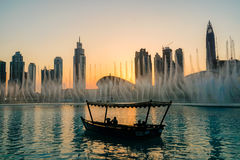 Dubai. In the summer of 2016. Arab Dhow on the background of the singing fountain in Dubai Mall. Stock Image