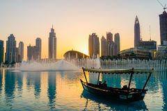 Dubai. In the summer of 2016. Arab Dhow on the background of the singing fountain in Dubai Mall. Royalty Free Stock Images