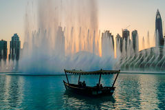Dubai. In the summer of 2016. Arab Dhow on the background of the singing fountain in Dubai Mall. Royalty Free Stock Photo