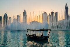 Dubai. In the summer of 2016. Arab Dhow on the background of the singing fountain in Dubai Mall. Stock Photo